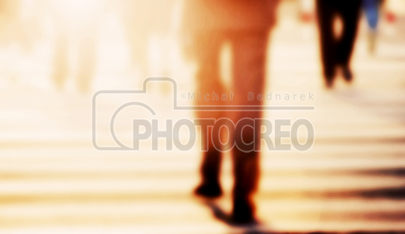 Businessman walking on the street. Blur