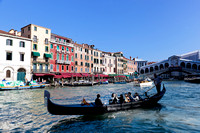 Venice, Italy. Gondola with tourists floats on Grand Canal