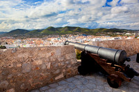 Cannon and panorama of Ibiza, Spain