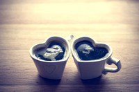 Black coffee, espresso in two heart shaped cups.. Love, Valentine's Day, vintage