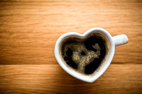 Black coffee, espresso in heart shaped cup. Love, Valentine's Day, vintage