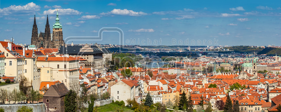 Prague, Czech Republic panorama. St. Vitus Cathedral over old town red roofs.