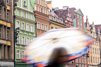Wroclaw, Poland. A person with umbrella on the rainy market square